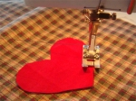 Sewing a heart on